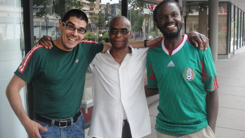 Three Mexico fans on Massachusetts Avenue