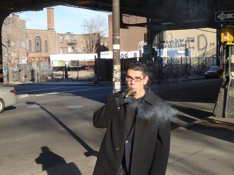 Noel Maurer smokin a cigar in Bushwick