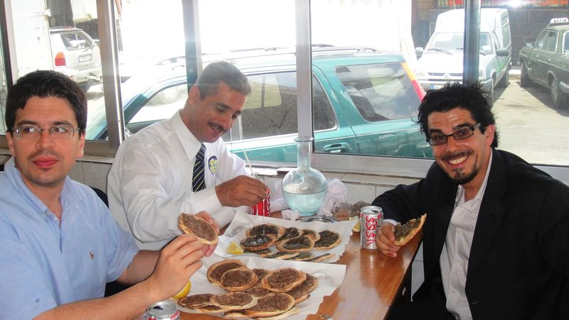 Noel Maurer and two other non-Lebanese Syrian-looking guys in Lebanon who are absolutely not refugees, although the same cannot be said of the people running the awesome diner they're eating in