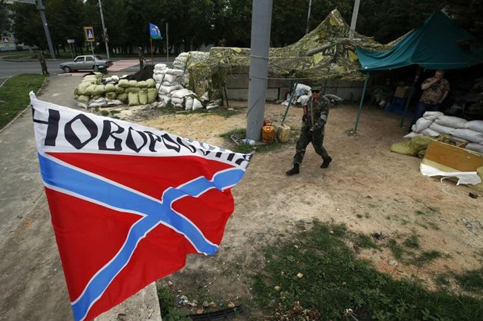 The flag of Novorossiya (New Russia) flies at a checkpoint manned by pro-Russian fighters (Reuters)